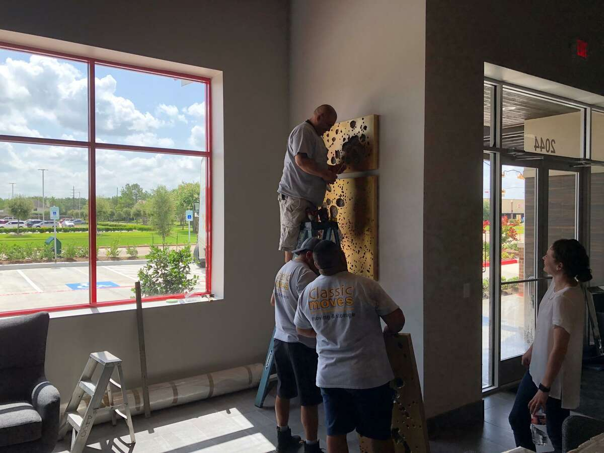 Service First Automotive workers put the final touches on the business at 2044 S. Mason near Highland Knolls.