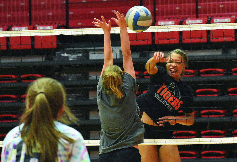 Edwardsville's Alexa Harris slams a kill past a Father McGivney blocker during a team camp at SIUE on Friday. Photo: Matthew Kamp