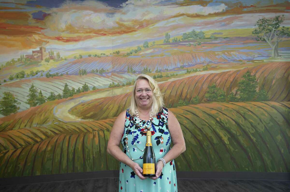 Harbor Point Wines & Spirits owner Terry Rogers poses inside her new store at 130 Washington Blvd., in the South End of Stamford, Conn., on Monday, July 16, 2018.