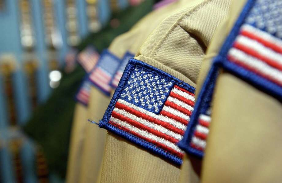 Boy Scout uniforms on a rack for sale at the Housatonic Council, Boy Scouts of America store. Photo: /