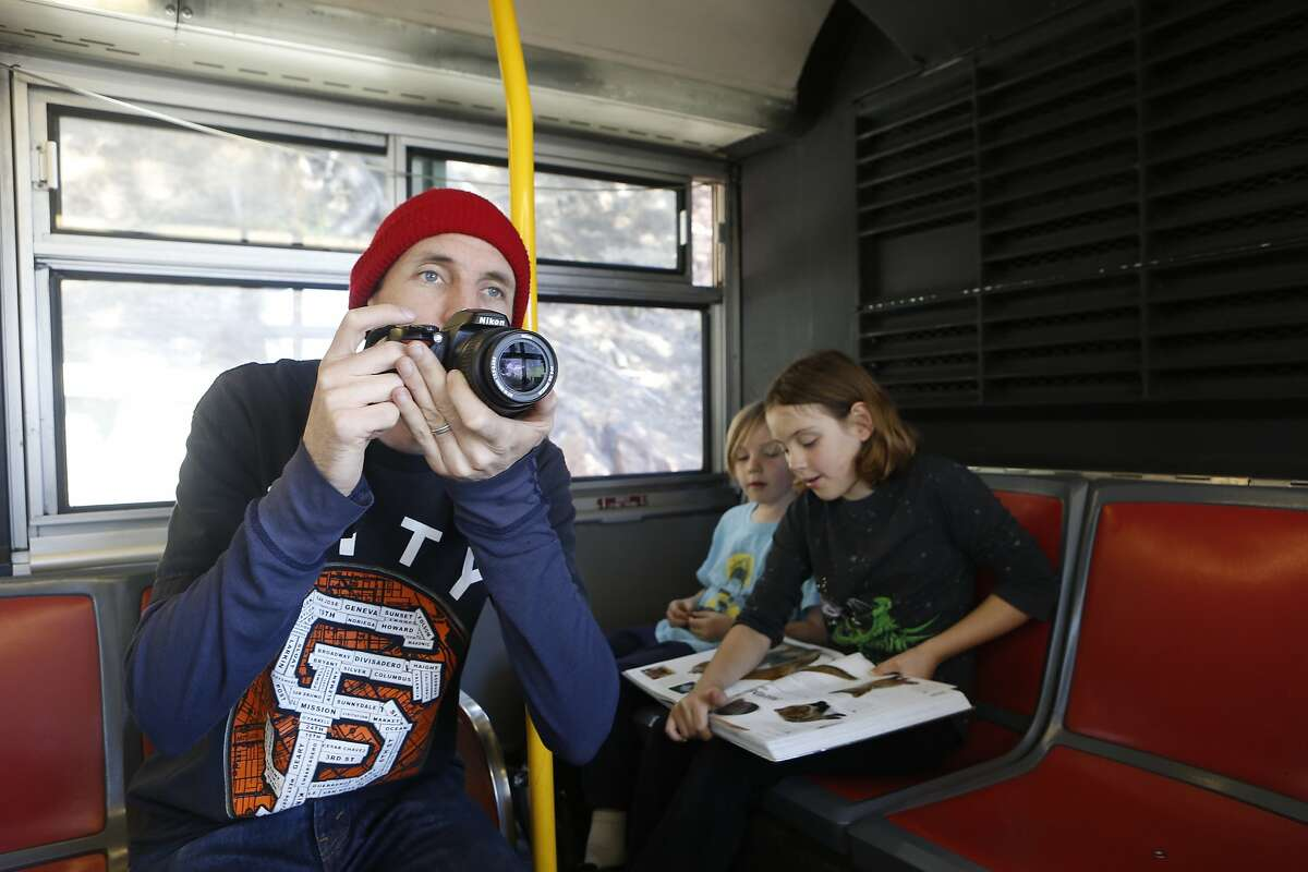 Mc Allen, left, and his children Lincoln Allen, 6, center, and Poppy Allen, 8, right, ride the 39 Coit from the Coit Parking Lot to the Columbus St. and Filbert St. stop on Wednesday, July 18, 2018 in San Francisco, Calif. They are riding every Muni line end to end over the course of the summer.