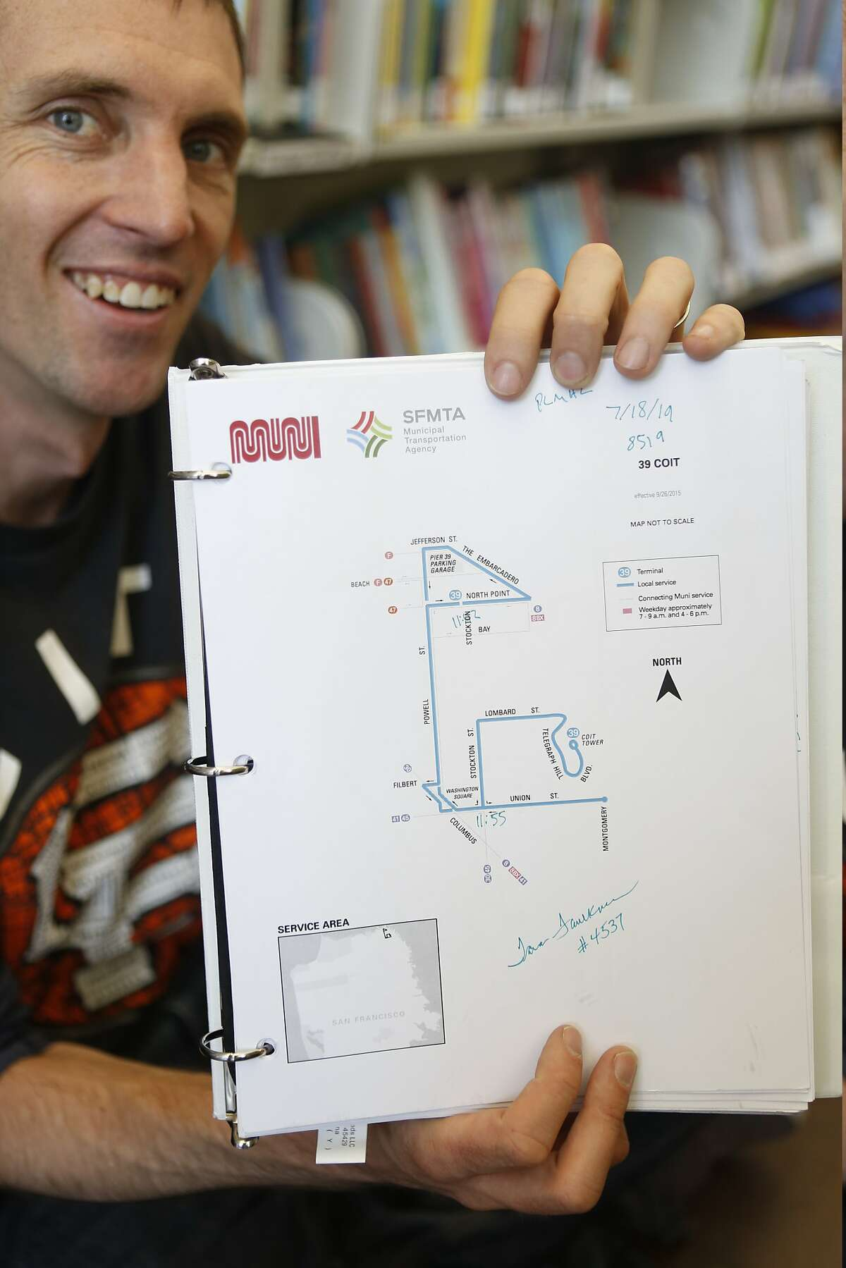 Mc Allen holds up a map of the Muni route he and his children took on Wednesday, July 18, 2018 in San Francisco, Calif. They are riding every Muni line end to end over the course of the summer, and Mc always tries to get the bus driver's signature.