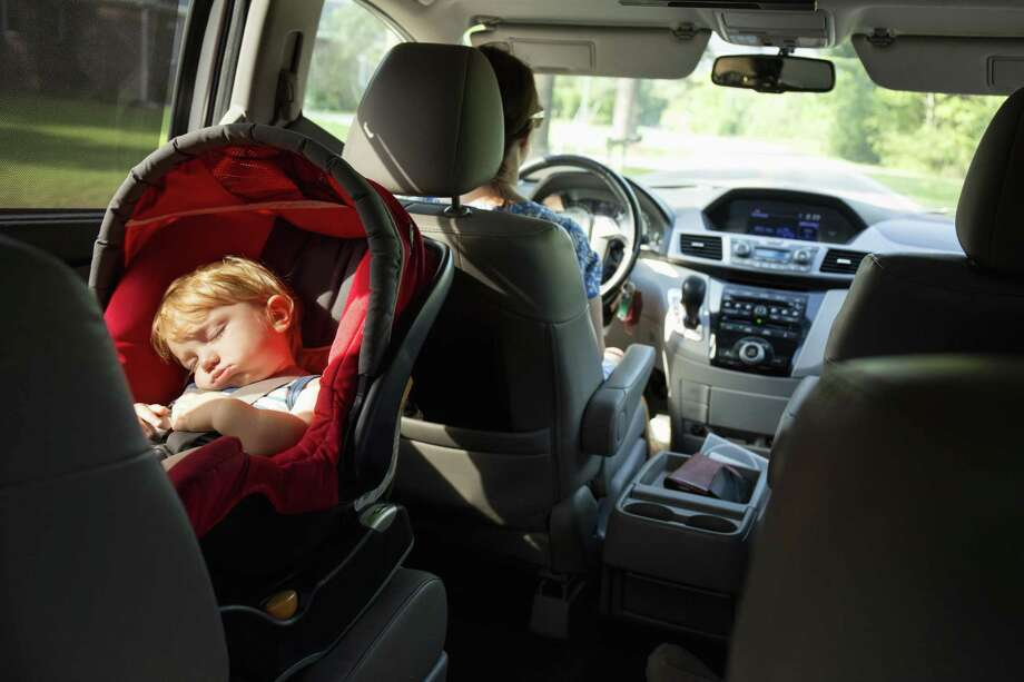 Caucasian mother driving car with baby son in car seat Photo: Roberto Westbrook, Contributor / Getty Images/Blend Images / This content is subject to copyright.