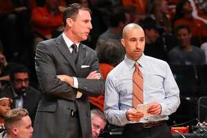 BROOKLYN, NY - NOVEMBER 21:  Texas Longhorns head coach Shaka Smart talks with Texas Longhorns assistant coach Darrin Horn during the second half of the NCAA basketball game between the Northwestern Wildcats and the Texas Longhorns on November 21, 2016, at Barclays Center in Brooklyn,NY.  (Photo by Rich Graessle/Icon Sportswire via Getty Images)