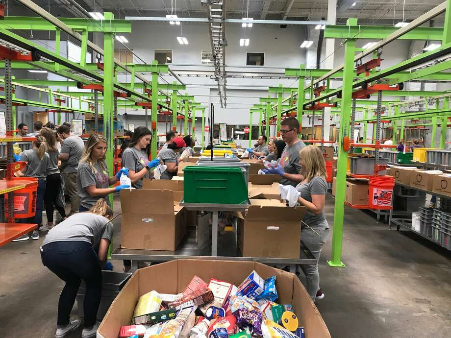Employees from the Rockets and Toyota Center, along with Rockets alumni, participated in the Rockets Give Back Volunteer Day at the Houston Food Bank. Photo: Parth Upadhyaya/Houston Chronicle
