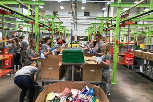 Employees from the Rockets and Toyota Center, along with Rockets alumni, participated in the Rockets Give Back Volunteer Day at the Houston Food Bank.