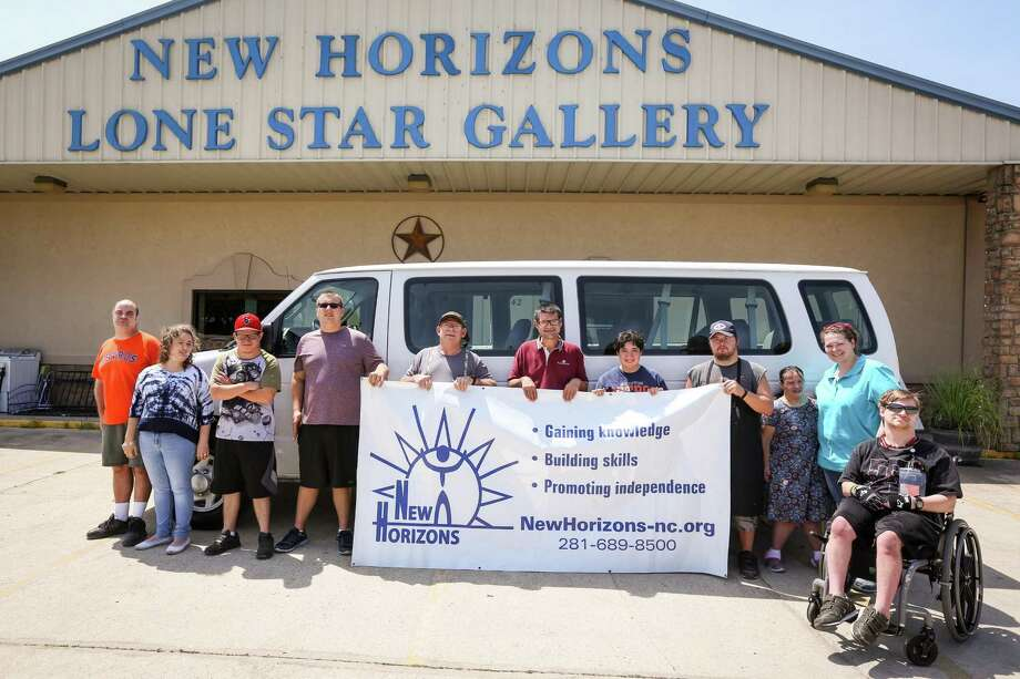 Staff and patrons pose for a photo with their new transport van on Monday, July 23, 2018, outside of the New Horizons Lone Star Gallery in New Caney. Photo: Michael Minasi, Staff Photographer / Houston Chronicle / © 2018 Houston Chronicle