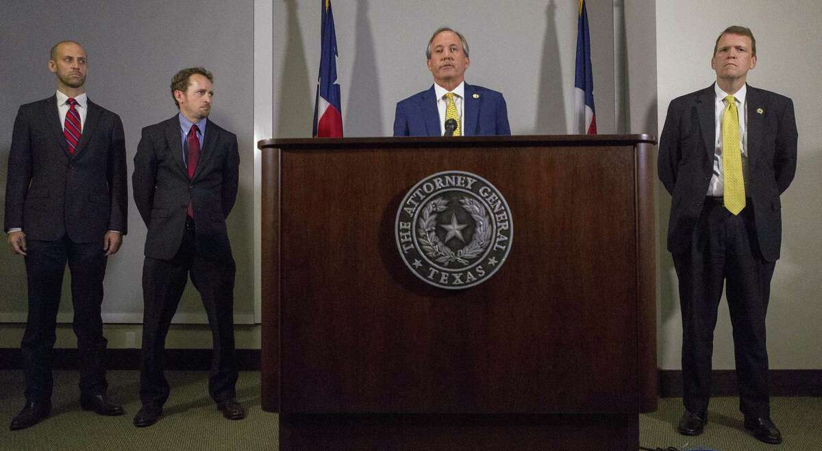 Texas Attorney General Ken Paxton announces his lawsuit against the federal government to end the Deferred Action for Childhood Arrivals (DACA) at his office in May. A coalition of businesses say the lawsuit would cause great harm to the state and national economy.