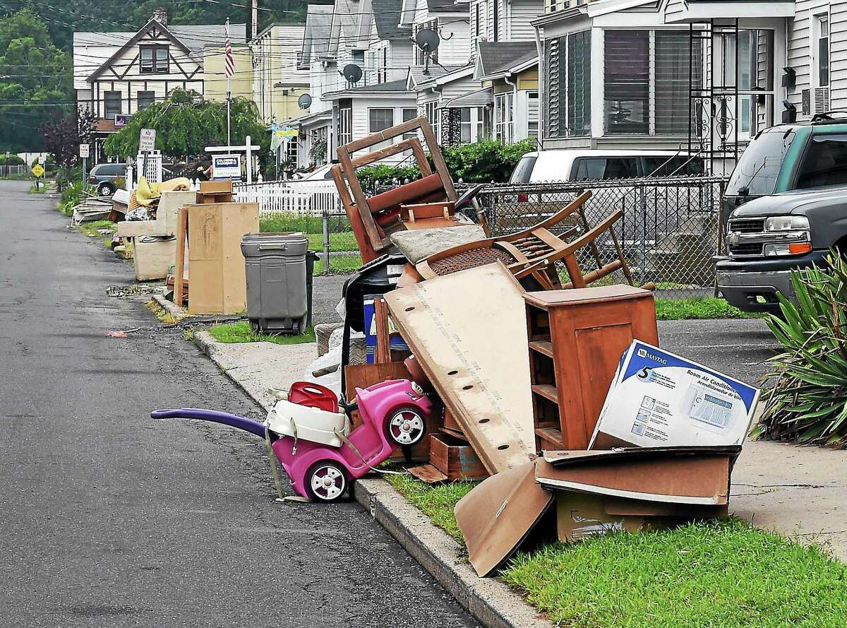 Bulk trash piled along Wharton Street in West Haven in this file photo.