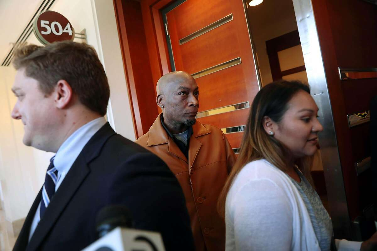 Dewayne Johnson (center), former groundskeeper for the Benicia Unified School District, leaves Department 504 with his wife Araceli Johnson (right) behind attorney Brent Wisner (left) at Superior Court of California during the Monsanto trial on Monday, July 23, 2018 in San Francisco, Calif.