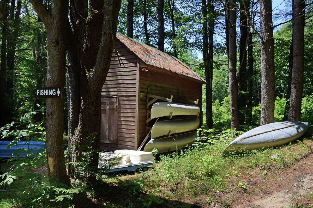 The Twin Rivers Council of the Boy Scouts of America will be selling off more properties to pay into a trust for survivors of sexual abuse. Pictured here is the boathouse at the old Boy Scout camp of Boy Haven from 2017 in Milton, N.Y. Now, a parcel of land from the 1,000-acre Camp Wakpominee in Fort Ann is slated to be sold. (John Carl D'Annibale/Times Union archive)