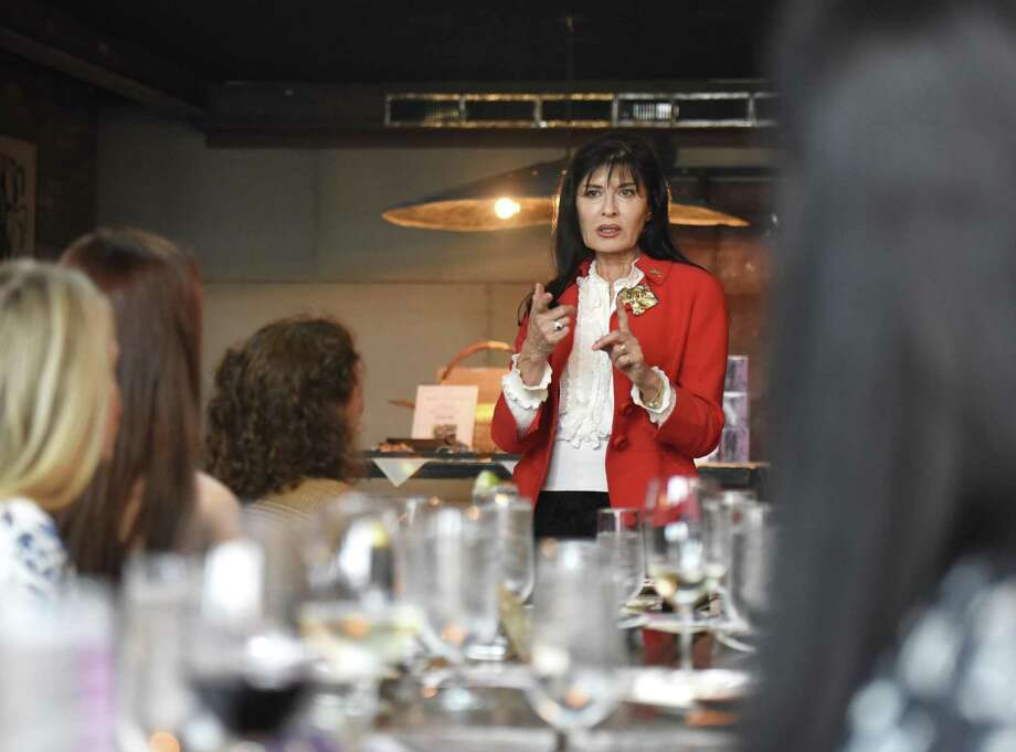 Friends of Autistic People (FAP) founder Brita Darany von Regensburg introduces Miss Connecticut 2017 Olga Litvinenko to speak at the Friends of Autistic People (FAP) luncheon fundraiser at The Spread in Greenwich, Conn. Thursday, April 19, 2018. Litvinenko spoke about her inspiring journey to become Miss Connecticut. The luncheon celebrated FAP's 20-year commitment to advocacy, education, and serving kids and adults with autism. There was also a live auction for jewelry, accessories, and a gift certificate for a one-on-one dinner with Miss Connecticut. Photo: Tyler Sizemore / Hearst Connecticut Media / Greenwich Time