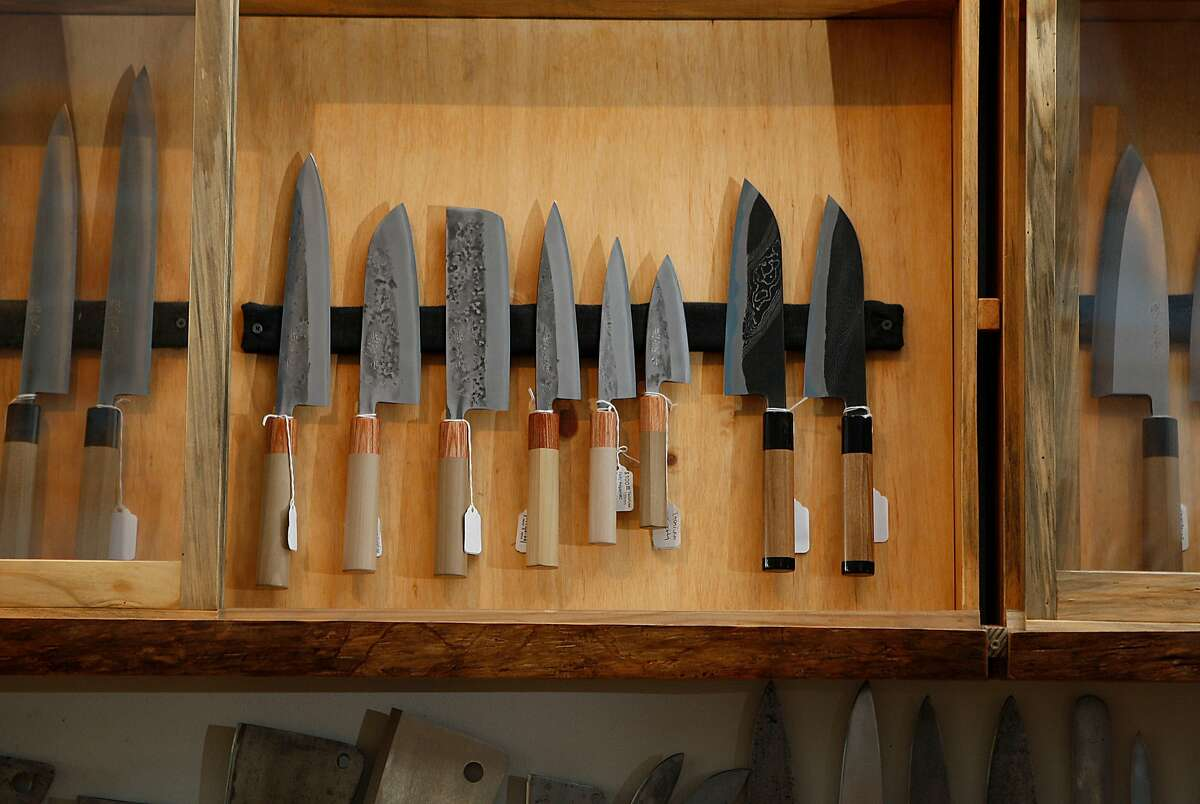 Tadafusa stainless clad blue steel (left) and Hinoura River Jump serles (right) displayed at Bernal Cutlery in San Francisco, Calif., on Tuesday, September 23, 2014.