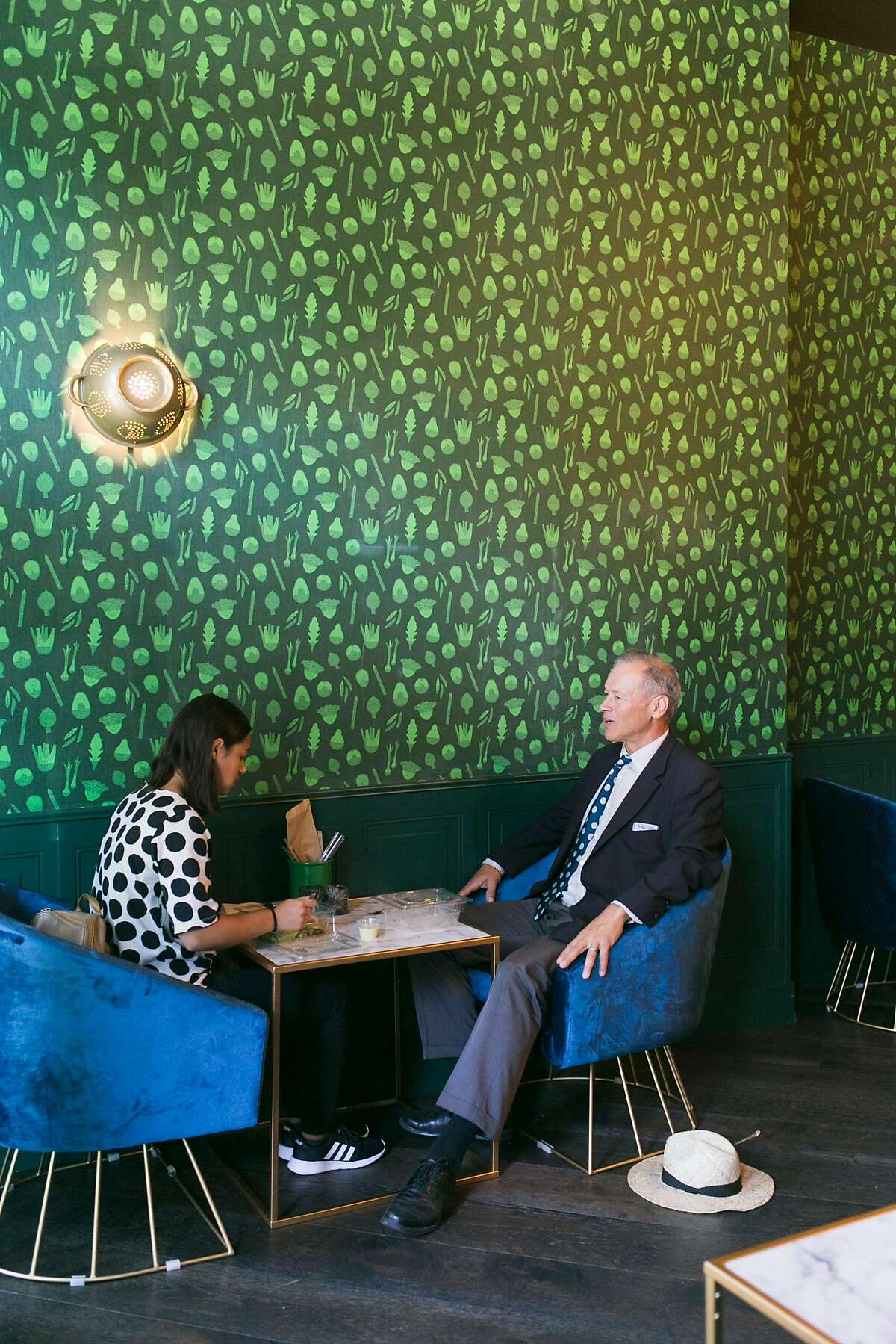 Hannah Moazed (left) and Steve Moazed have lunch inside the Salad Lounge at Mixt on Valencia Street in San Francisco, Calif. on Friday, July 20, 2018.