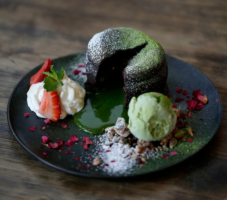 The Matcha Lava Cake flows matcha lava when cut open at U:Dessert Story on Sunday, July 22, 2018 in San Francisco, Calif.
