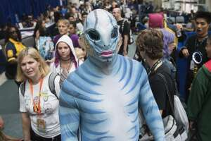 """SAN DIEGO, CA - JULY 20: A cosplayer dressed as the Merman from """"The Shape of Water"""" walk the floor during Comic-Con 2018 in San Diego on Friday, July 20, 2018. (Photo by Kevin Sullivan/Orange County Register via Getty Images)"""
