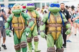 SAN DIEGO, CA - JULY 19:  Fans in costume attend Comic-Con International on July 19, 2018 in San Diego, California.  (Photo by Daniel Knighton/FilmMagic)