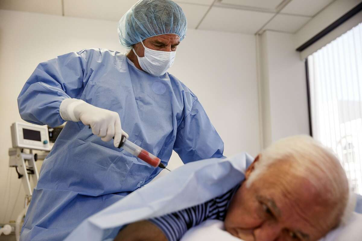 Beverly Hills, CA - August 16: Dr. Mark Berman performs liposuction to retrieve fat for stem cell therapies from a patient in his office on Tuesday, August 16, 2016 in Beverly Hills, CA. The stem cells are extracted via liposuction of fat cells which are spun in a specially patented