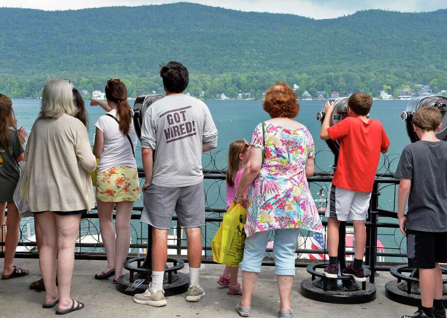 Tourists take in the lake sights on Thursday, July 5, 2018, in Lake George, N.Y. (John Carl D'Annibale/Times Union) Photo: John Carl D'Annibale