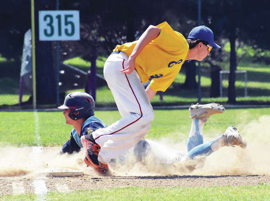 Edwardsville Post 199 third baseman Cole Hampton (front) attempts to tag out an advancing Carmi runner at third ase during the first inning at the legion state tourney on Monday in Aviston. Photo:       Matthew Kamp / Hearst Newspapers