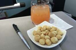 A nice plate of Mauna Loa macadamia nuts- tasty, but high in calories in first class on Hawaiian Airlines
