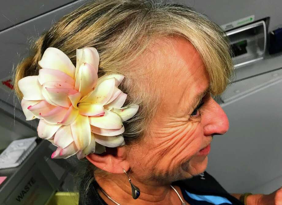 Some Hawaiian Airlines flight attendants wear fresh flowers from their yards in their hair- not required by the airline, but appreciated by passengers! Photo: Chris McGinnis