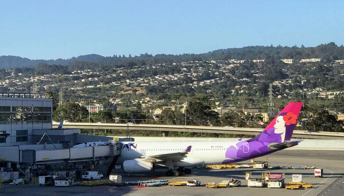 An exotic greeting from Hawaiian Airlines Airbus A330 with Pualani on the tail helps ease passengers into the aloha spirit.