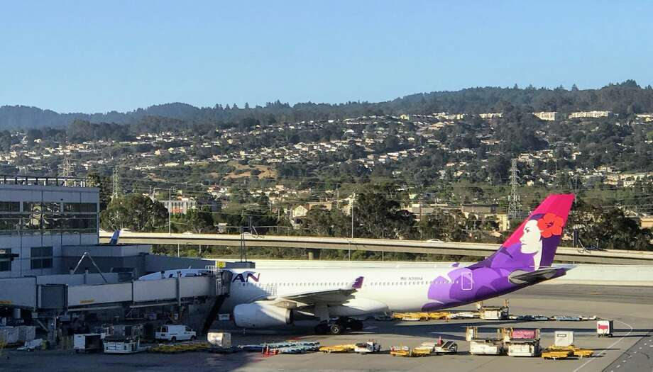 An exotic greeting from Hawaiian Airlines Airbus A330 with Pualani on the tail helps ease passengers into the aloha spirit. Photo: Chris McGinnis