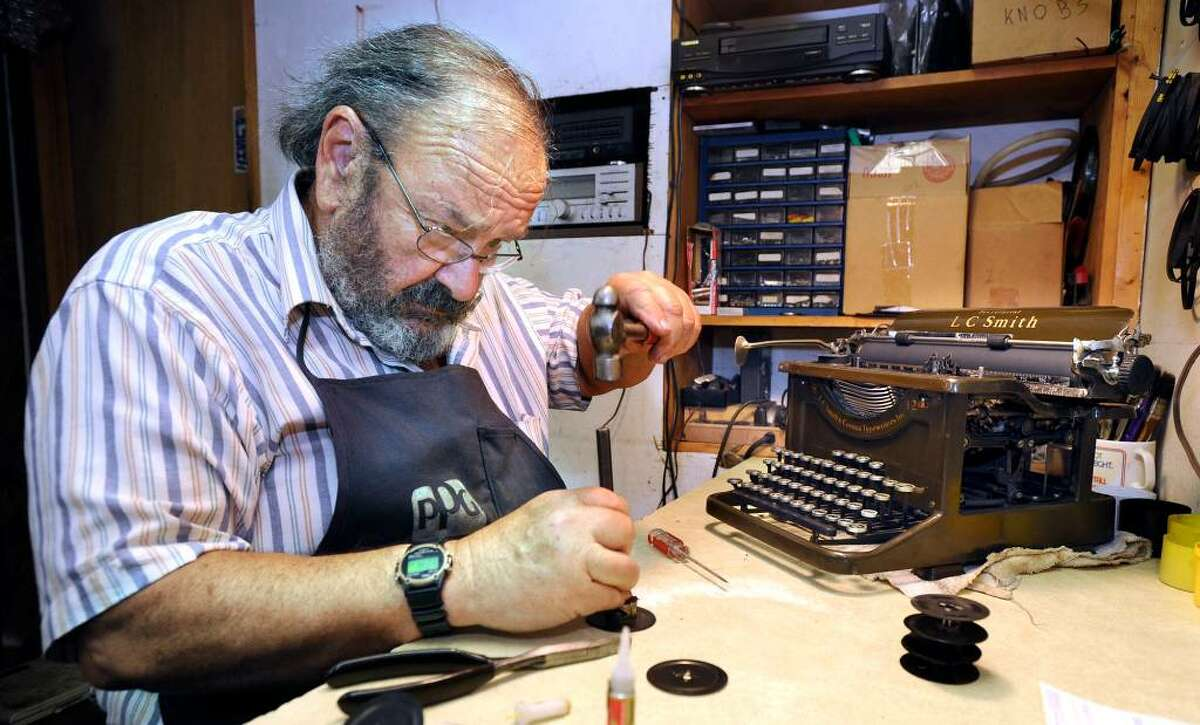 David Morrill, who runs American Typewriter and Amtype Repair Service in New Milford, works on restoring a 1936 LC Smith Secretarial office manual typewriter.