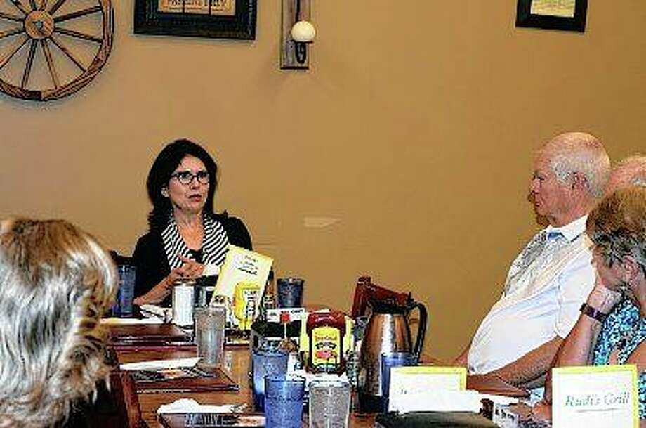Lt. Gov. Evelyn Sanguinetti visits Rudi's restaurant in Jacksonville on Monday to visit with supporters and answer their questions before the November election.