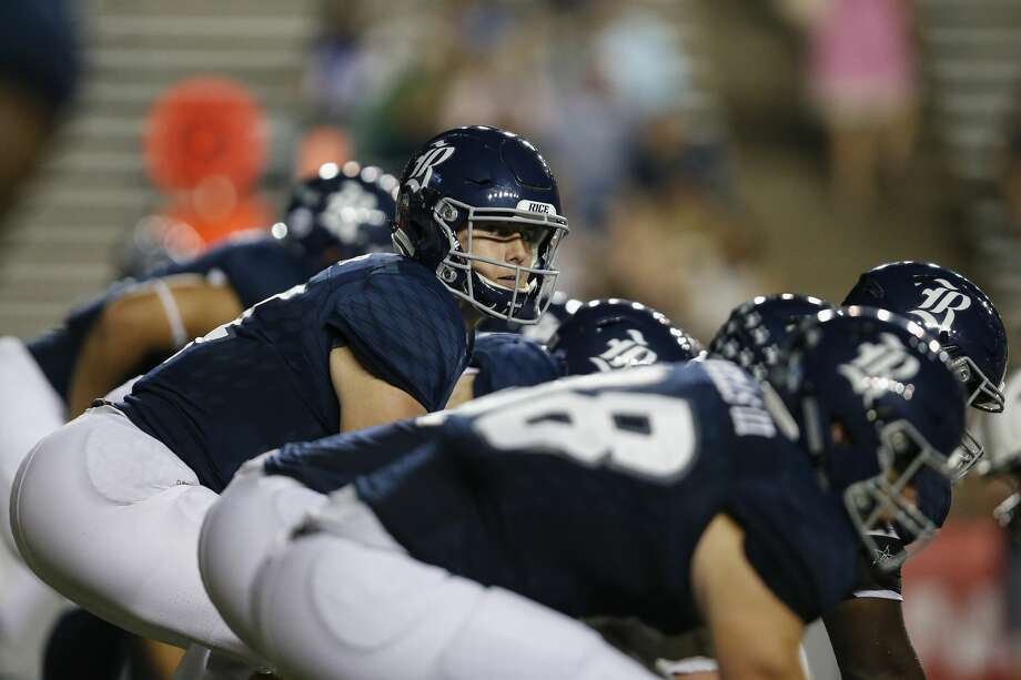 HOUSTON, TX - SEPTEMBER 23:  Jackson Tyner #14 of the Rice Owls takes the snap at the line of scrimmage in the fourth quarter against the FIU Golden Panthers at Rice Stadium on September 23, 2017 in Houston, Texas.  (Photo by Tim Warner/Getty Images) PHOTOS: Browse through the gallery for a look at top players to watch out for against Rice this season. Photo: Tim Warner/Getty Images