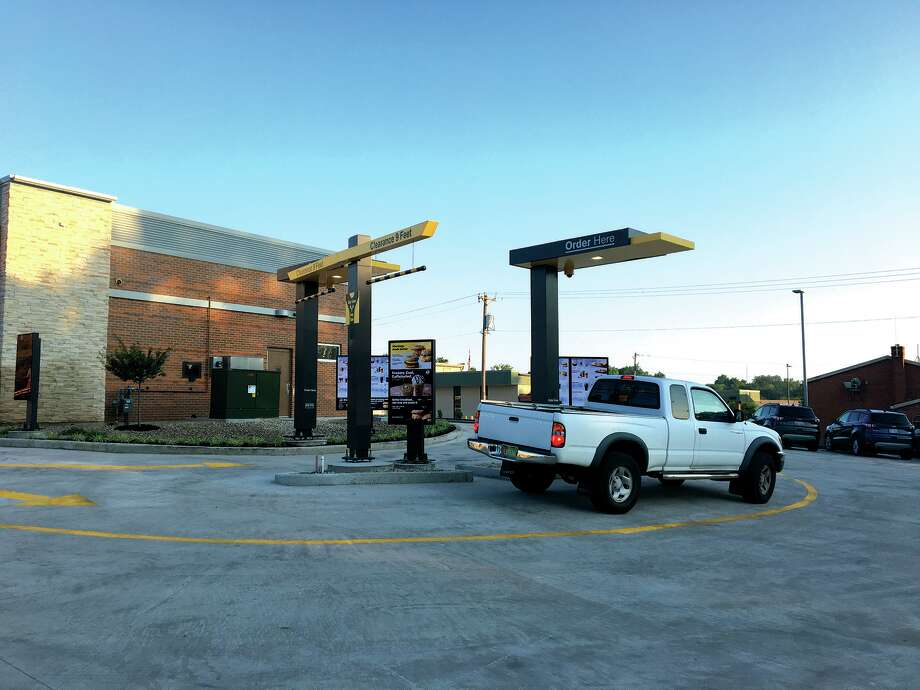 After having been torn down and rebuilt, the McDonald's on Troy Road opened for business Tuesday morning. The restaurant features a dual drive-thru and a new indoor playground. Photo: Photos By Bill Tucker