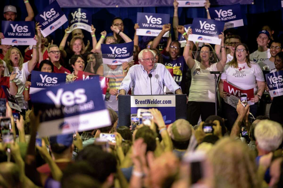 Bernie Sanders speaks at a campaign event for James Thompson, a Kansas House candidate, in Wichita, July 20, 2018. Less than four weeks after scoring a stunning upset in a Democratic House primary in New York, Alexandria Ocasio-Cortez stepped out onto the national campaign stage for the first time to take her message to the heartland. (Hilary Swift/The New York Times)