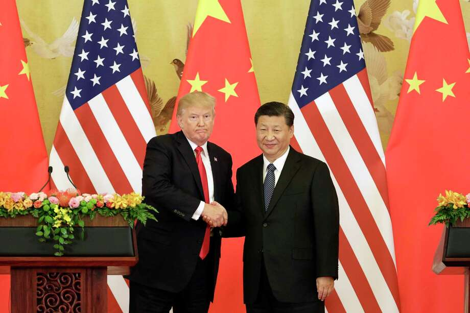 U.S. President Donald Trump and Chinese President Xi Jinping shake hands during a news conference in Beijing in November. Photo: Bloomberg Photo By Qilai Shen / © 2018 Bloomberg Finance LP