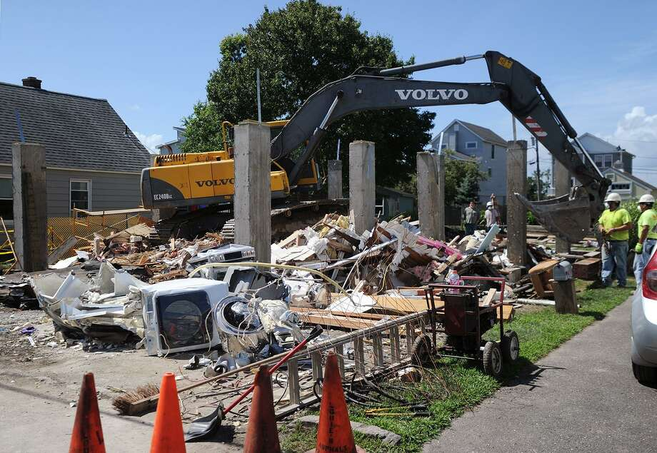 A home at 24 Cooper Avenue in Milford, Conn is demolished on Tuesday, July 24, 2018 after it collapsed while being raised on to new concrete pilings on Monday. Photo: Brian A. Pounds / Hearst Connecticut Media / Connecticut Post