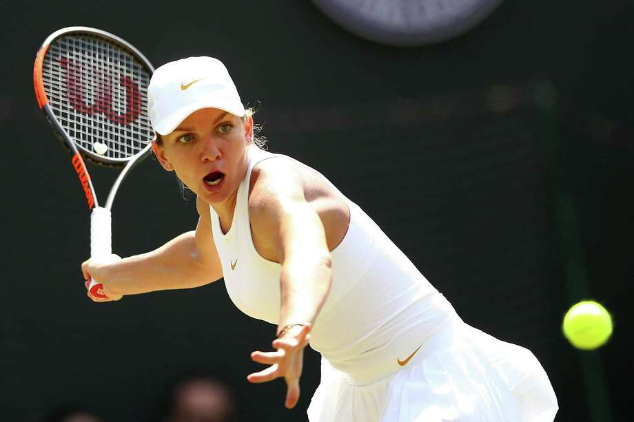 World No. 1 Simona Halep, returning a shot against Su-Wei Hsieh July 7 at Wimbledon, has committed to play at the Connecticut Open next month in New Haven. (Photo by Michael Steele/Getty Images) Photo: Michael Steele / Getty Images / 2018 Getty Images