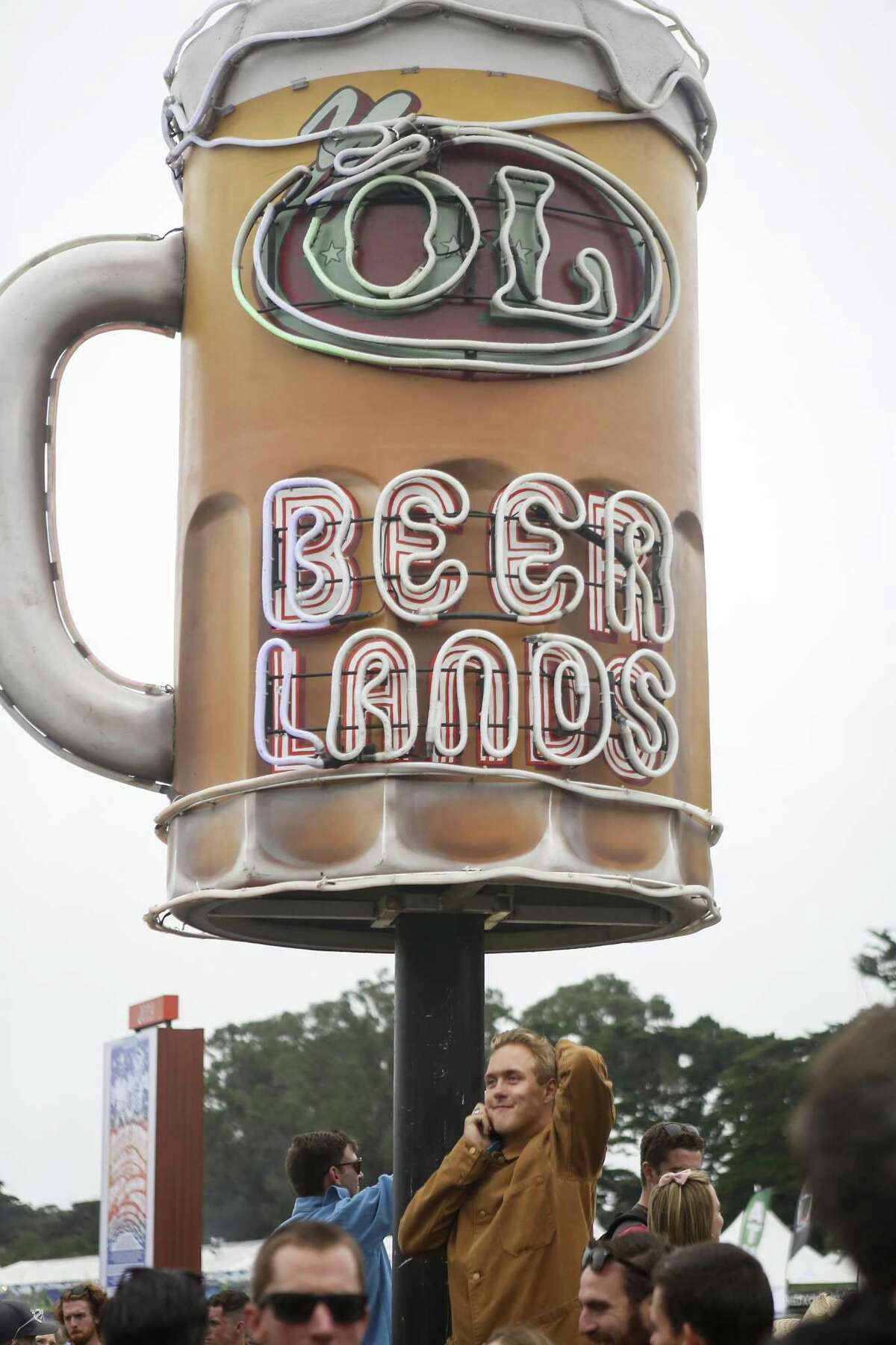 A man looks for a friend in the crowd outside Beer Lands during the 10th annual Outside Lands Festival in Golden Gate Park in San Francisco on Saturday, August 12, 2017.