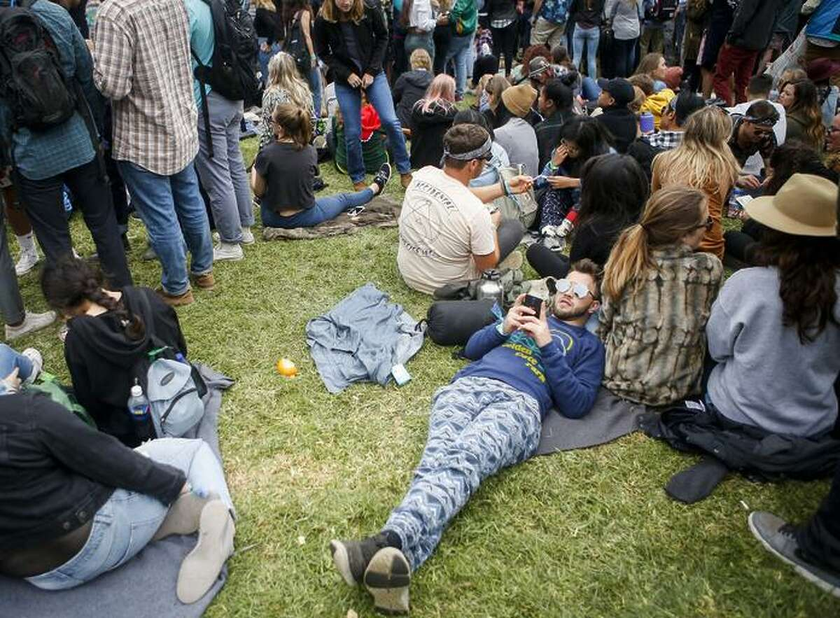 Festivalgoers relax during a Thundercat performance on the Twin Peaks stage at last year's Outside Lands festival in Golden Gate Park. This year's fest runs Aug. 10-12.