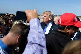 US President Donald Trump greets people as he arrives at Kansas City International Airport July 24, 2018 in Kansas City, Missouri. Trump will give remarks at the Veterans of Foreign Wars of the United States National Convention in Kansas City.   / AFP PHOTO / Brendan SmialowskiBRENDAN SMIALOWSKI/AFP/Getty Images