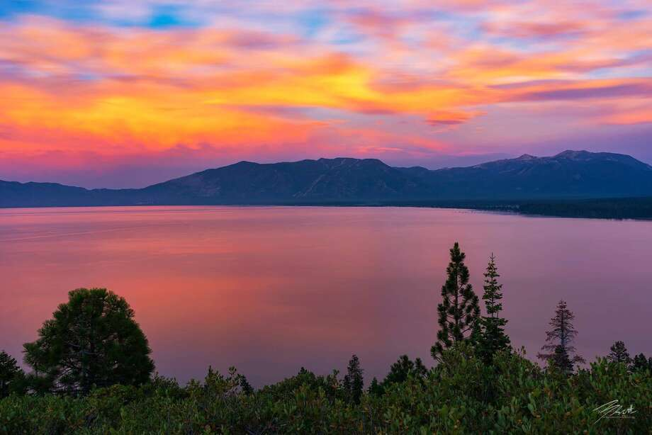 Wildfire smoke-filled skies combined with thunderstorm clouds made for spectacular sunsets over the weekend and Monday evening in the Tahoe Basin, as the skies over the lake turned rich reds, oranges and pinks. Photo: Brad Scott / Laketahoeprints.com