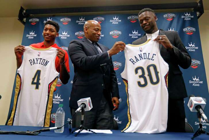 New Orleans Pelicans general manager Dell Demps, center, poses for a photo at a news conference announcing the recent signings of Elfrid Payton, left, and Julius Randle, at their NBA basketball training facility in Metairie, La., Friday, July 13, 2018. (AP Photo/Gerald Herbert)