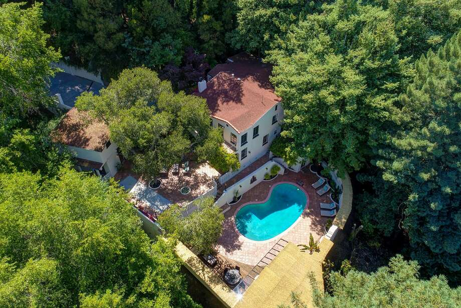 300 Summit Ave. in Mill Valley rests on nearly an acre and includes a pool and mature trees. Photo: Jason Wells Photography Photos