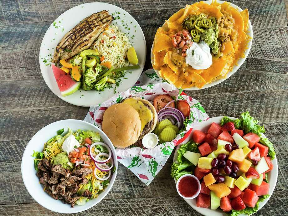 Entrees from Jax Grill, which will be opening a new restaurant in Katy in 2019. Photo: Gary Wise