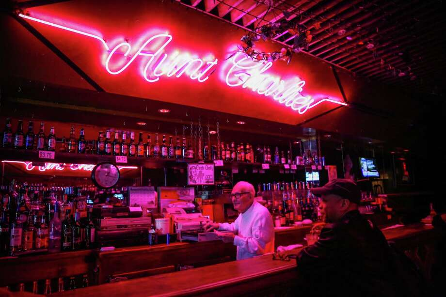 Aunt Charlie's Lounge is known for its bright-pink neon sign. Photo: Gabrielle Lurie / The Chronicle 2016 / ONLINE_YES