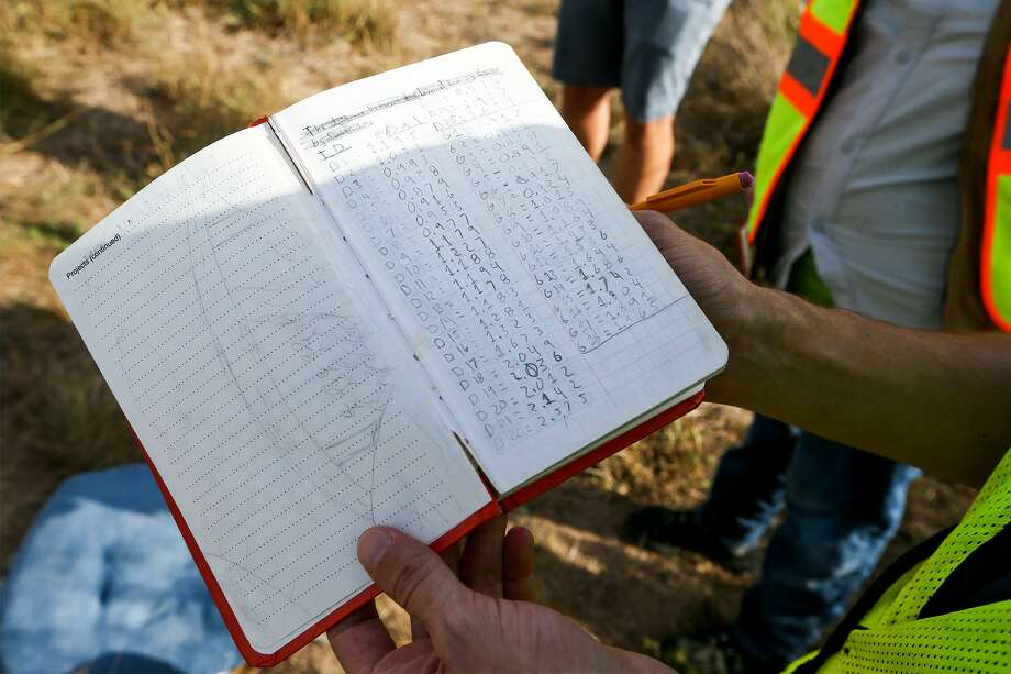San Antonio College students Jonathan Garcia, 25,  holds a ledger showing gravity readings taken at the potential Bee Bluff impact crater approximately 13 miles south of Uvalde on Friday, July 13, 2018.  The crater, approximately 6.7 km (4.2 miles) in diameter, was presumably caused by a meteor that struck the earth 45 to 20 million years ago.  MARVIN PFEIFFER/mpfeiffer@express-news.net Photo: Marvin Pfeiffer, Staff / San Antonio Express-News / Express-News 2018