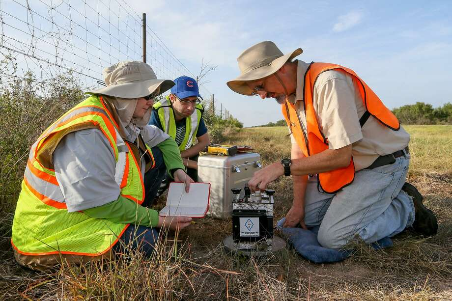 SAC students Emily Reyes (from left) and Jonathan Garcia take readings from a  gravity meter with geologist and adjunct faculty instructor Dwight Jurena. Photo: Marvin Pfeiffer / Staff Photographer / Express-News 2018