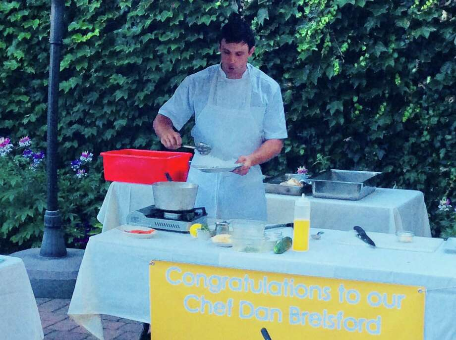 Daniel Brelsford preparing a dish at Consiglio's Cooking class held on the outdoor garden patio. The three courses he demonstrated used some of the mystery basket ingredients that were required to be used on the show. Photo: Stephen Fries /