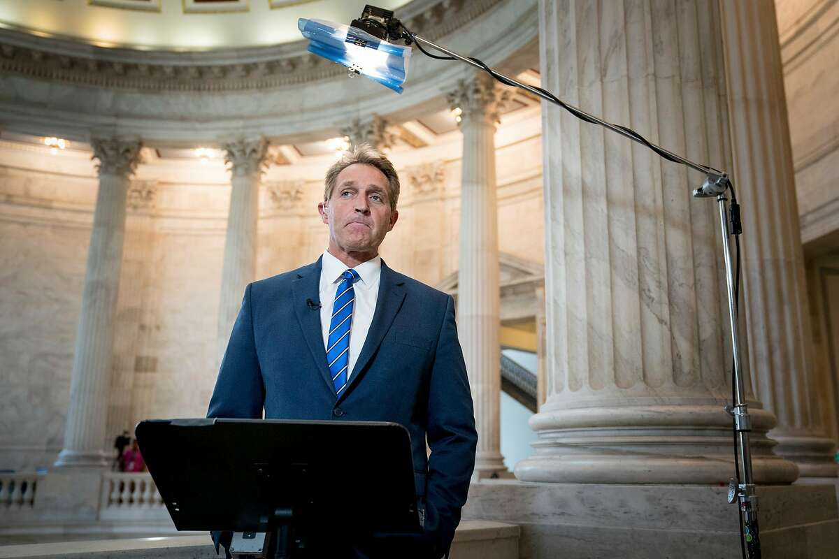 Sen. Jeff Flake (R-Ariz.) does a television interview on Capitol Hill in Washington, July 16, 2018. Republicans across the ideological spectrum rebuked President Trump after Monday�s extraordinary news conference with President Vladimir Putin of Russia. (Erin Schaff/The New York Times)