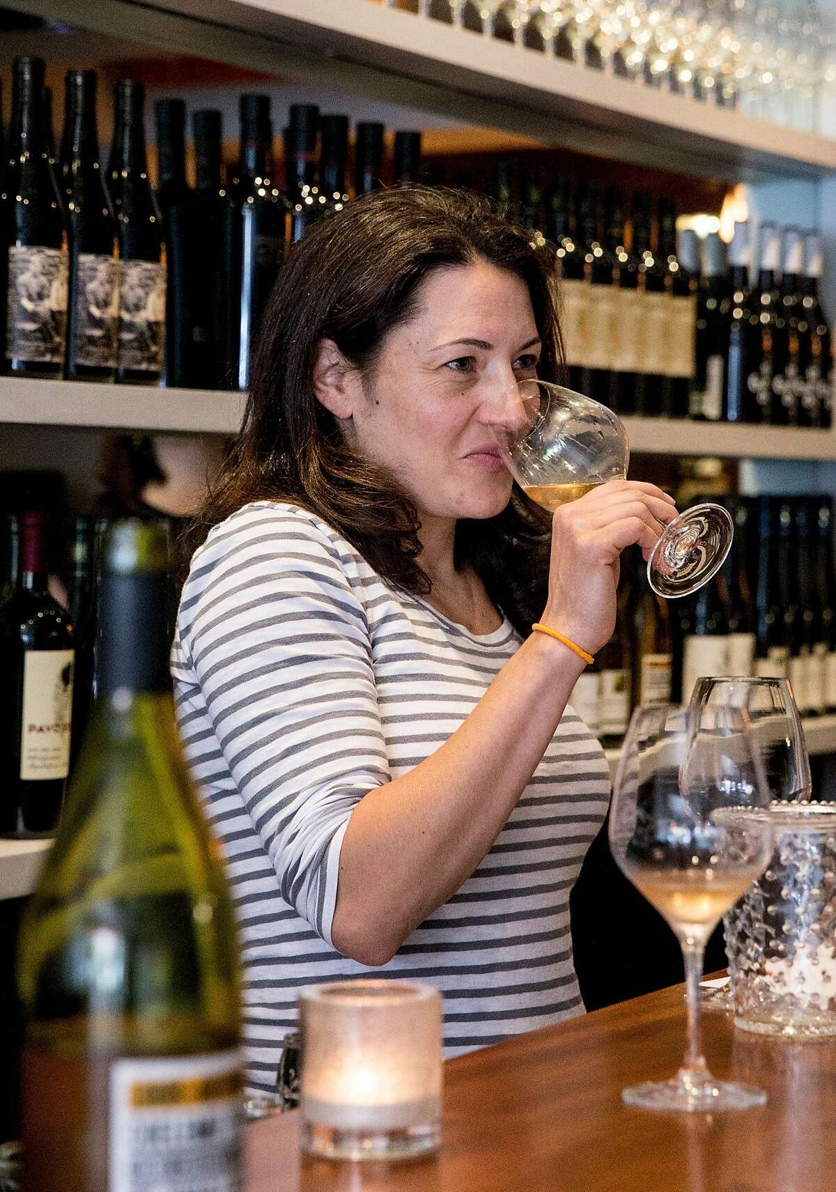 Wine director Sarah Trubnick tastes potential new wines with a seller at Parigo in the Marina district of San Francisco, Calif. Thursday, July 19, 2018.