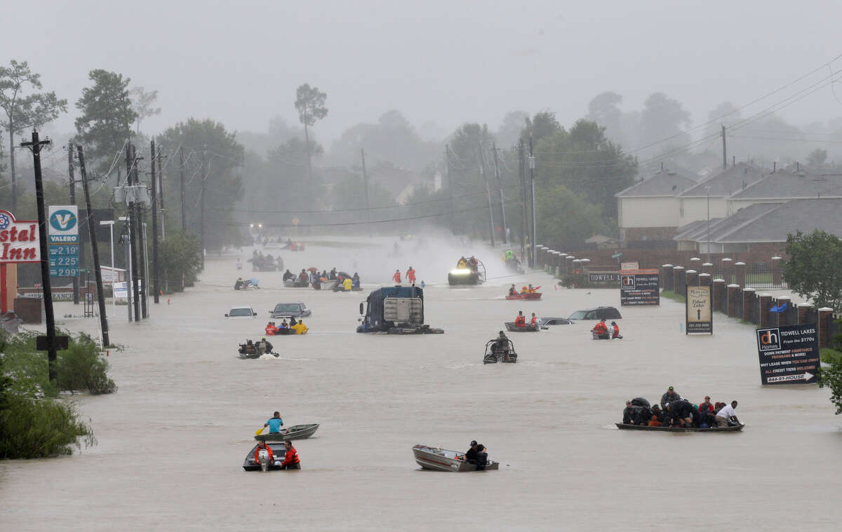 Rescue boats work along Tidwell at the east Sam Houston Tollway helping to evacuate people Monday, August 28, 2017. Much of the area is flooded from rains after Hurricane Harvey.